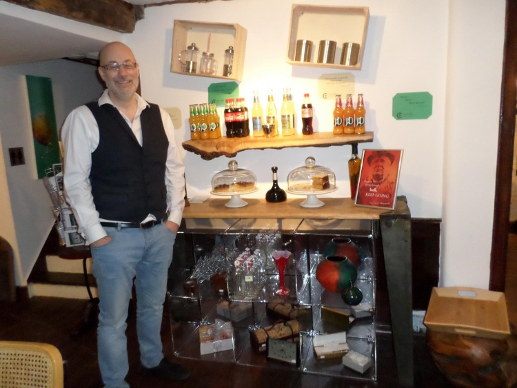 Inside Churchills cafefeaturing the drinks and cakes available for sale