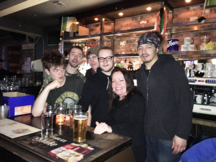 Dirty Bare Feet posing for a photo in a bar with presenter Colly D
